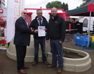 Presenting the winners certificate during BPPF (l-r), John Lewis, Publisher of Pig World, which sponsors the Innovation Awards, congratulates Adrian Lawson of Rattlerow and Jamie MacDonald of Con-Tented Products